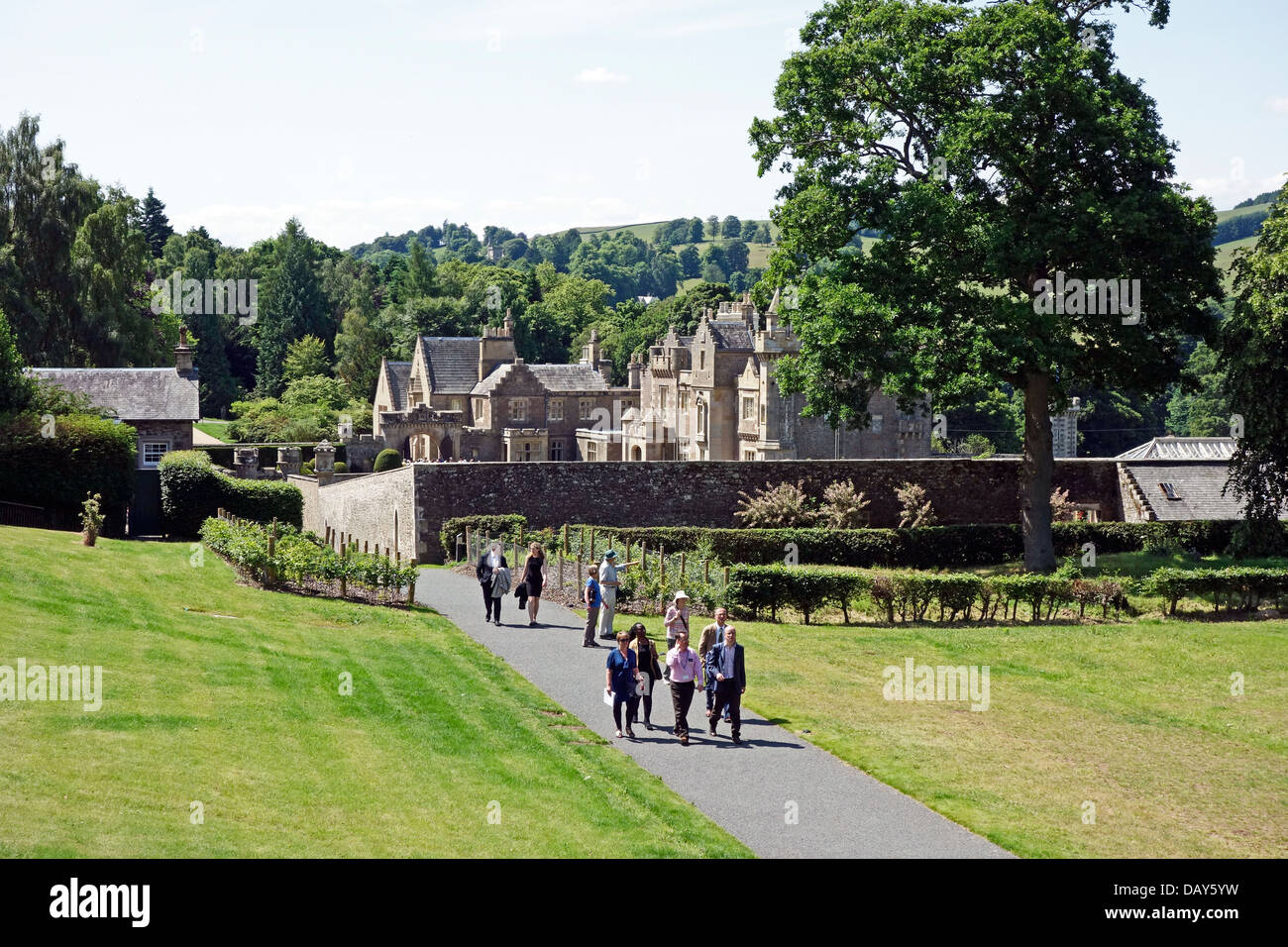 Visitors returning from Abbotsford House home of Sir Walter Scott in Melrose Scottish Borders Scotland - Stock Image