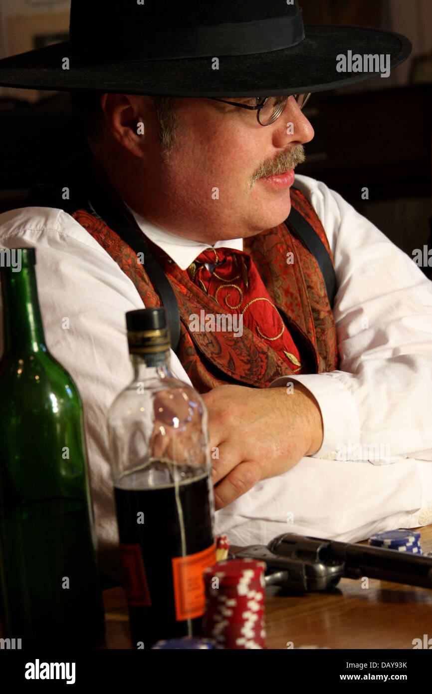 An old western actor playing poker - Stock Image