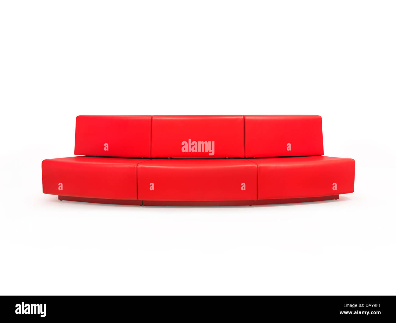 Long red couch isolated on white background with clipping path - Stock Image
