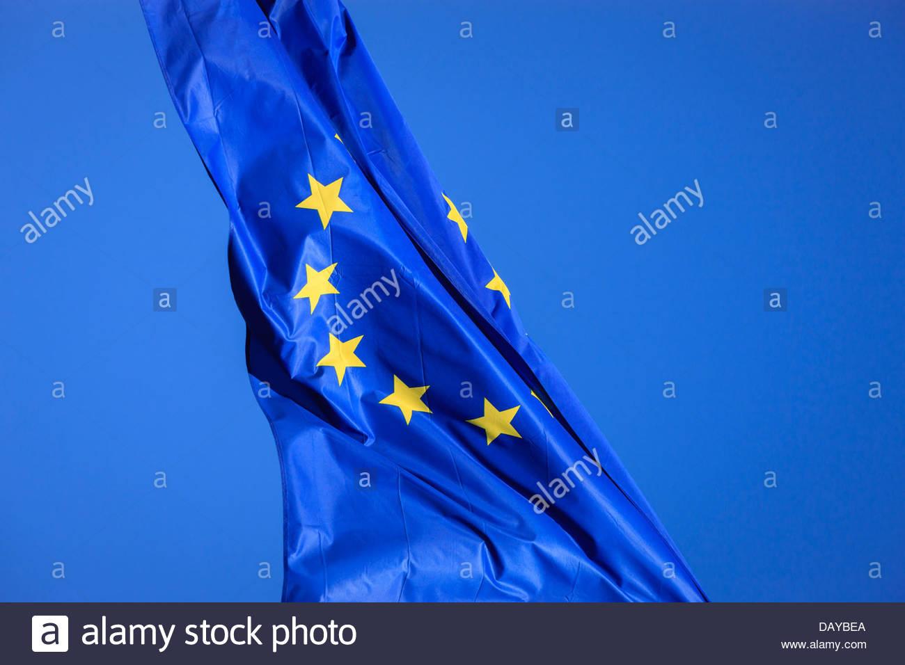 European Union Eu flag flying against blue sky - Stock Image