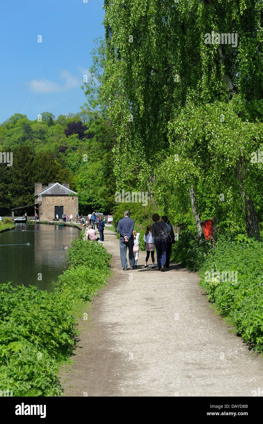 People walking along the canal towpath Cromford canal Derbyshire England uk - Stock Image