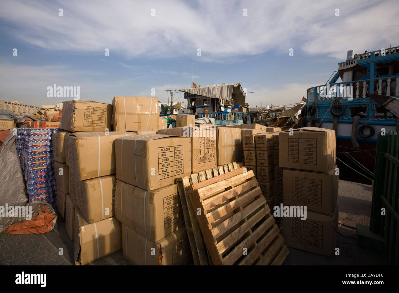 Goods being unloaded and loaded for transport, Dubai, United Arab