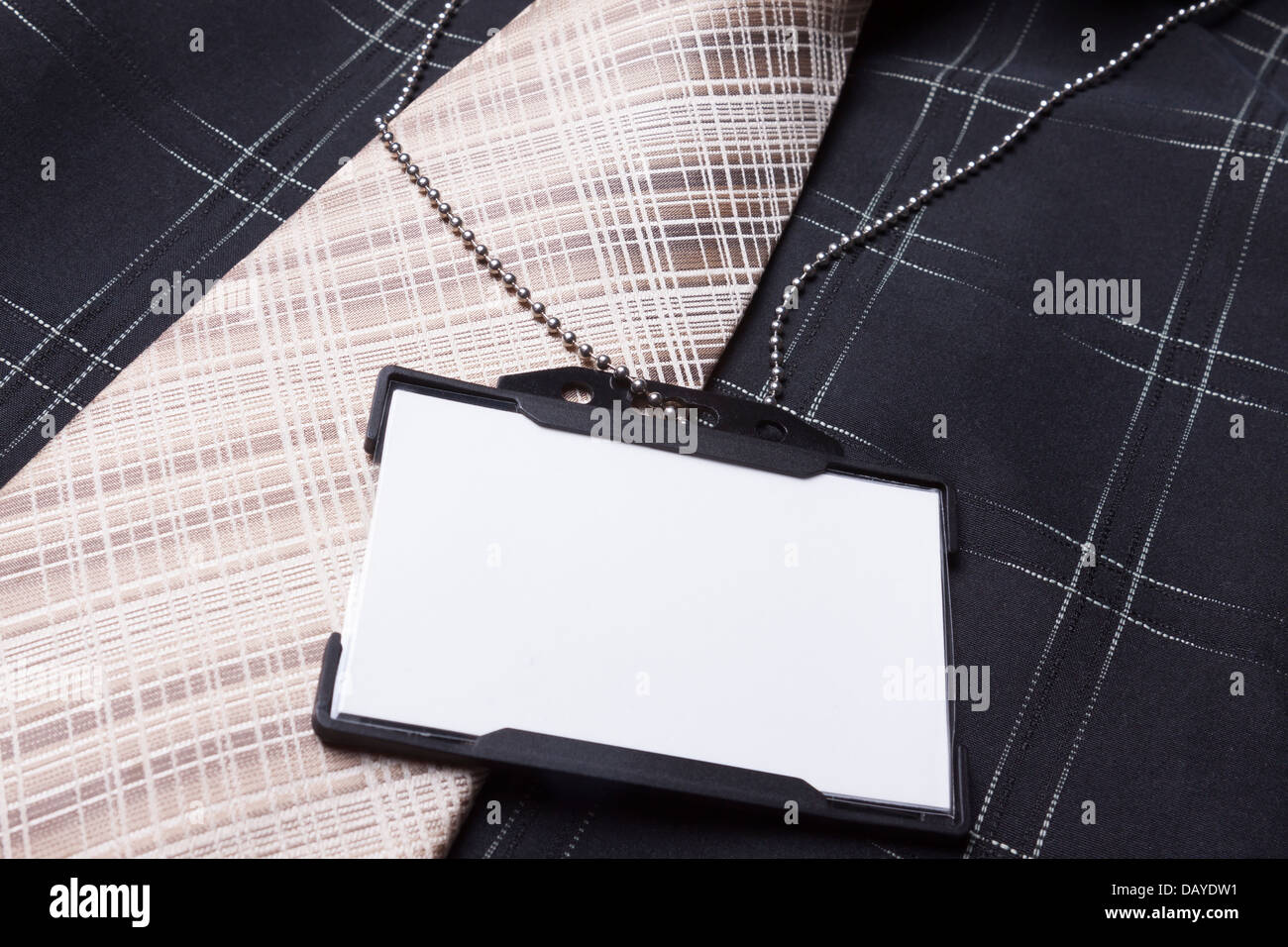 Card empty ID badge on man suit - Stock Image