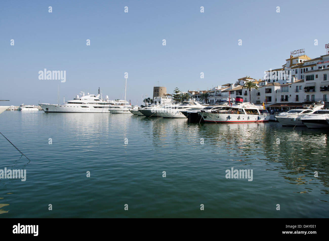 The marina of Puerto banus in Marbella with old watch tower. Costa del Sol, Spain. - Stock Image