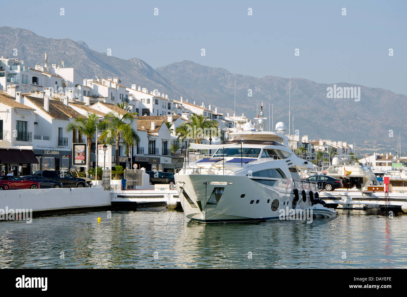 The marina of Puerto banus in marbella with la concha in the background - Stock Image