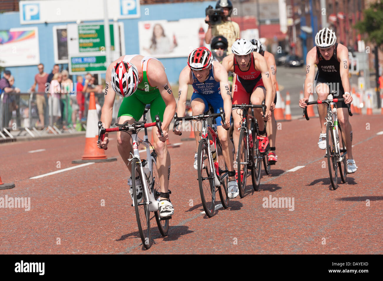Men Elite Sprint Distance Triathlon supreme athletes super fit and fast drafting on the bike cycle leg cycling fast Stock Photo
