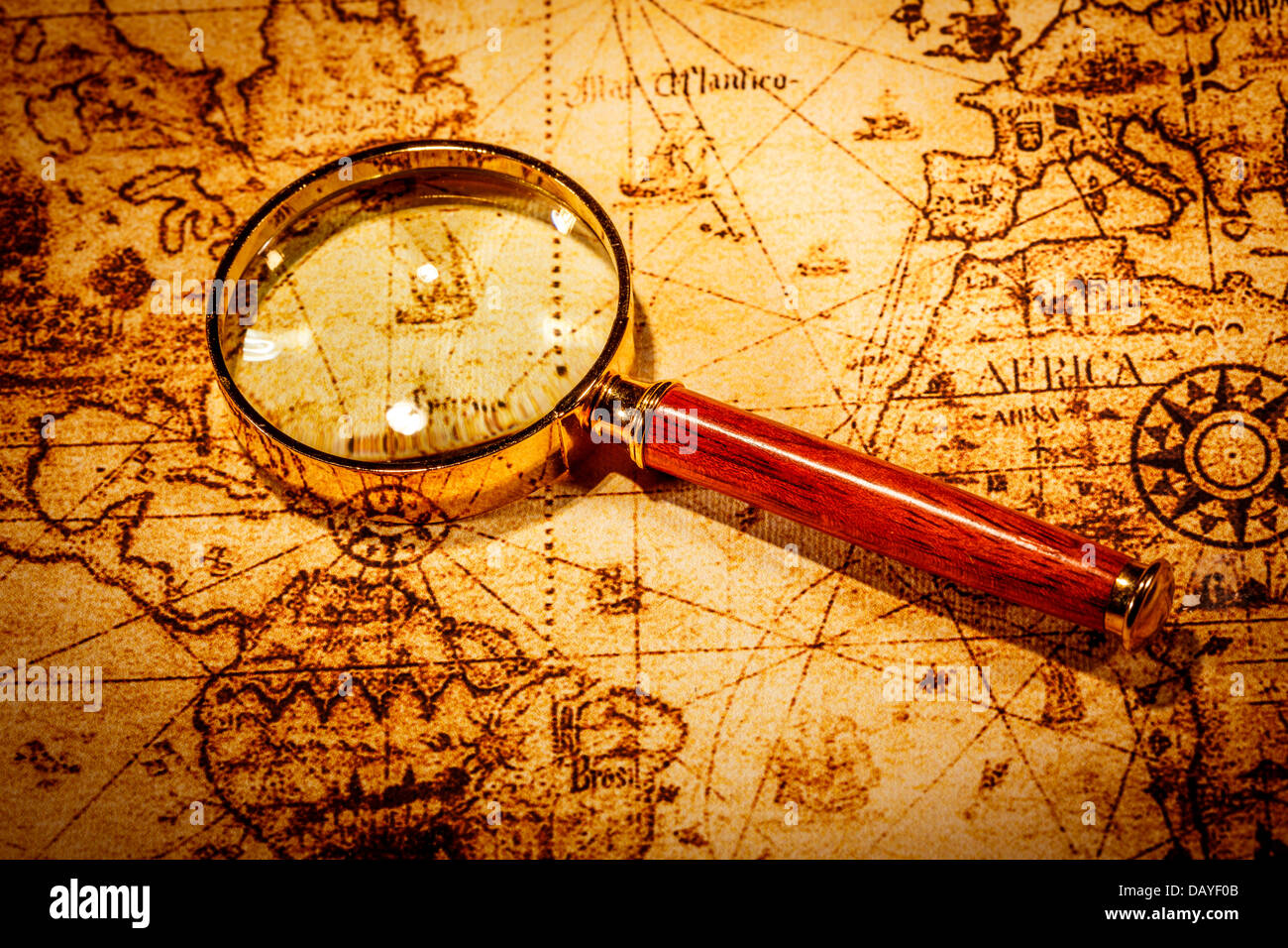Vintage still life vintage magnifying glass lies on an ancient vintage magnifying glass lies on an ancient world map gumiabroncs Gallery
