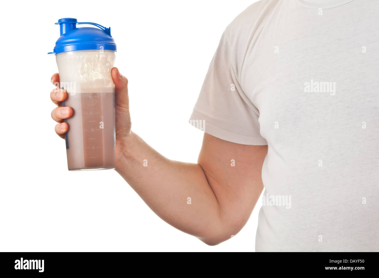 Man holding his post workout chocolate whey protein shake - Stock Image