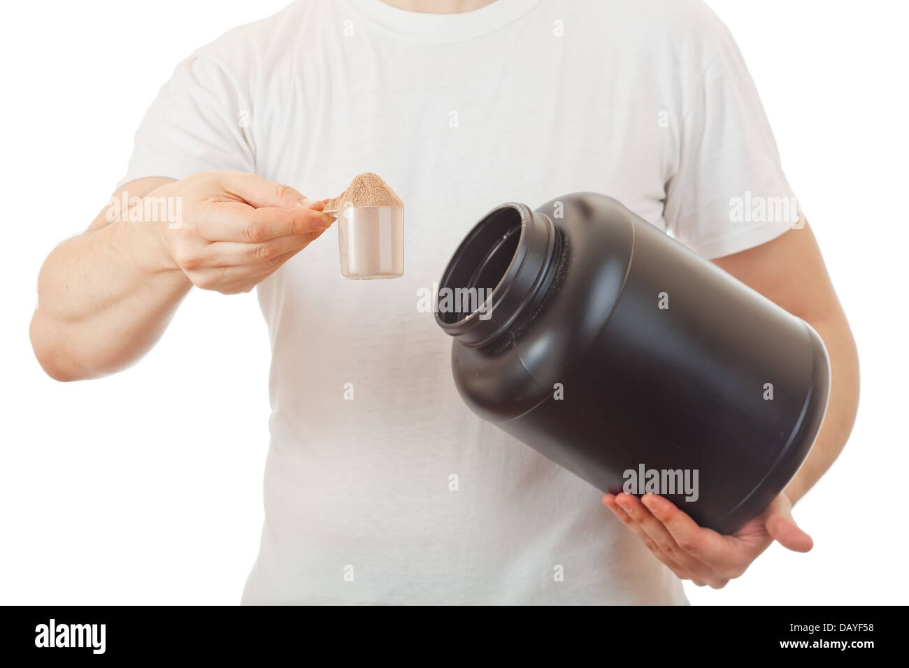 Man's  holding scoop of  chocolate whey protein shake - Stock Image