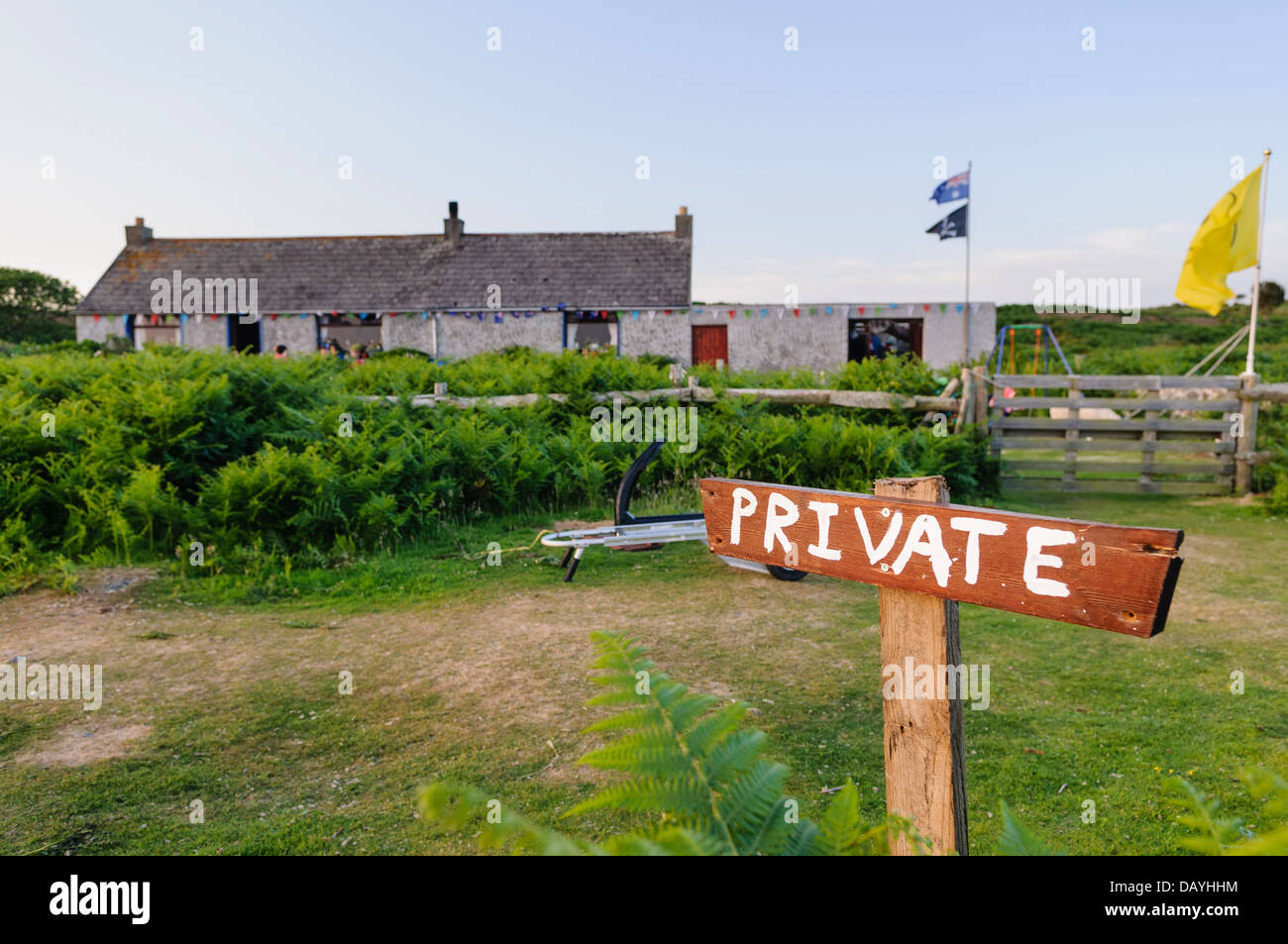 Private sign outside a house on the Copeland Island, Northern Ireland, Flags are flown when the property is occupied - Stock Image