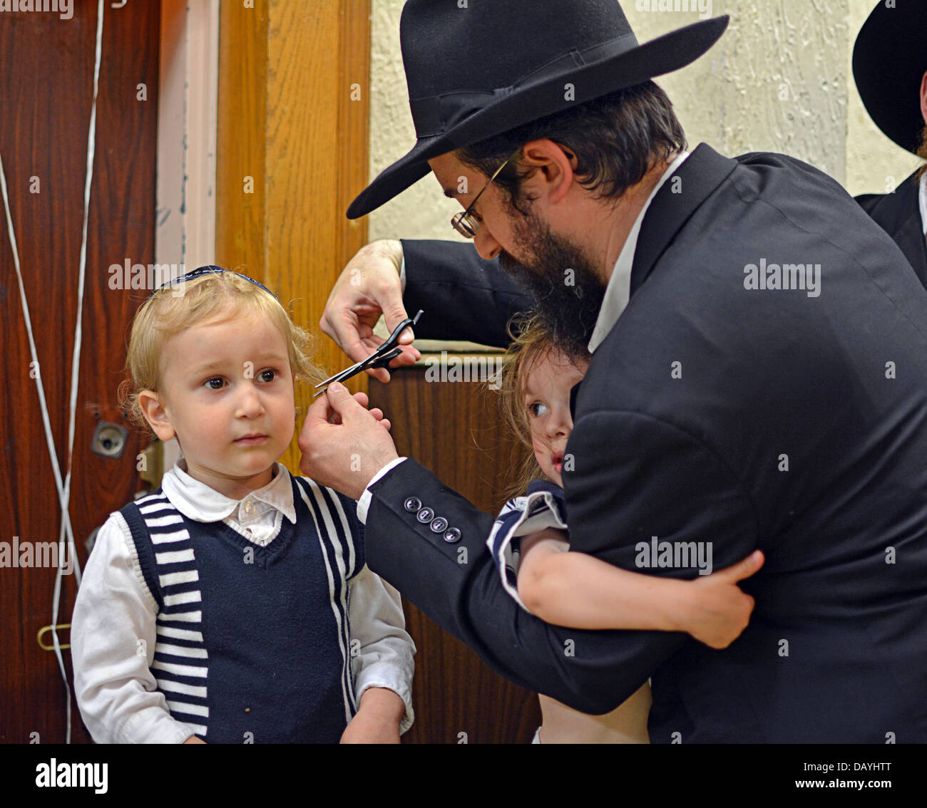 A 3 Year Old Religious Jewish Boy Getting His First Haircut At A