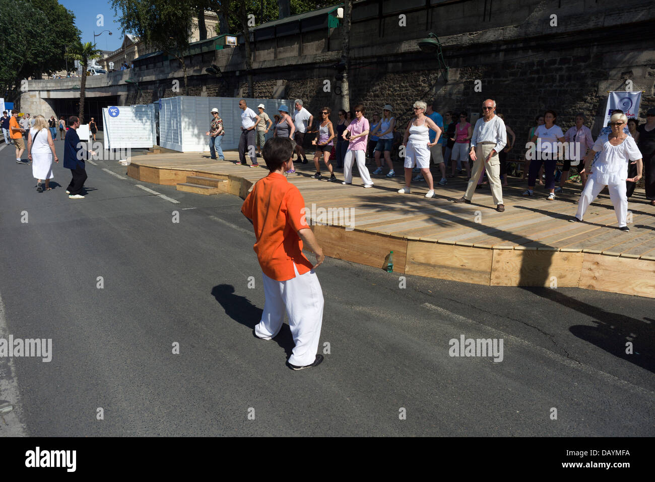 A group Tai chi session at Paris Plages on opening day, 20th July 2013, Paris, France - Stock Image