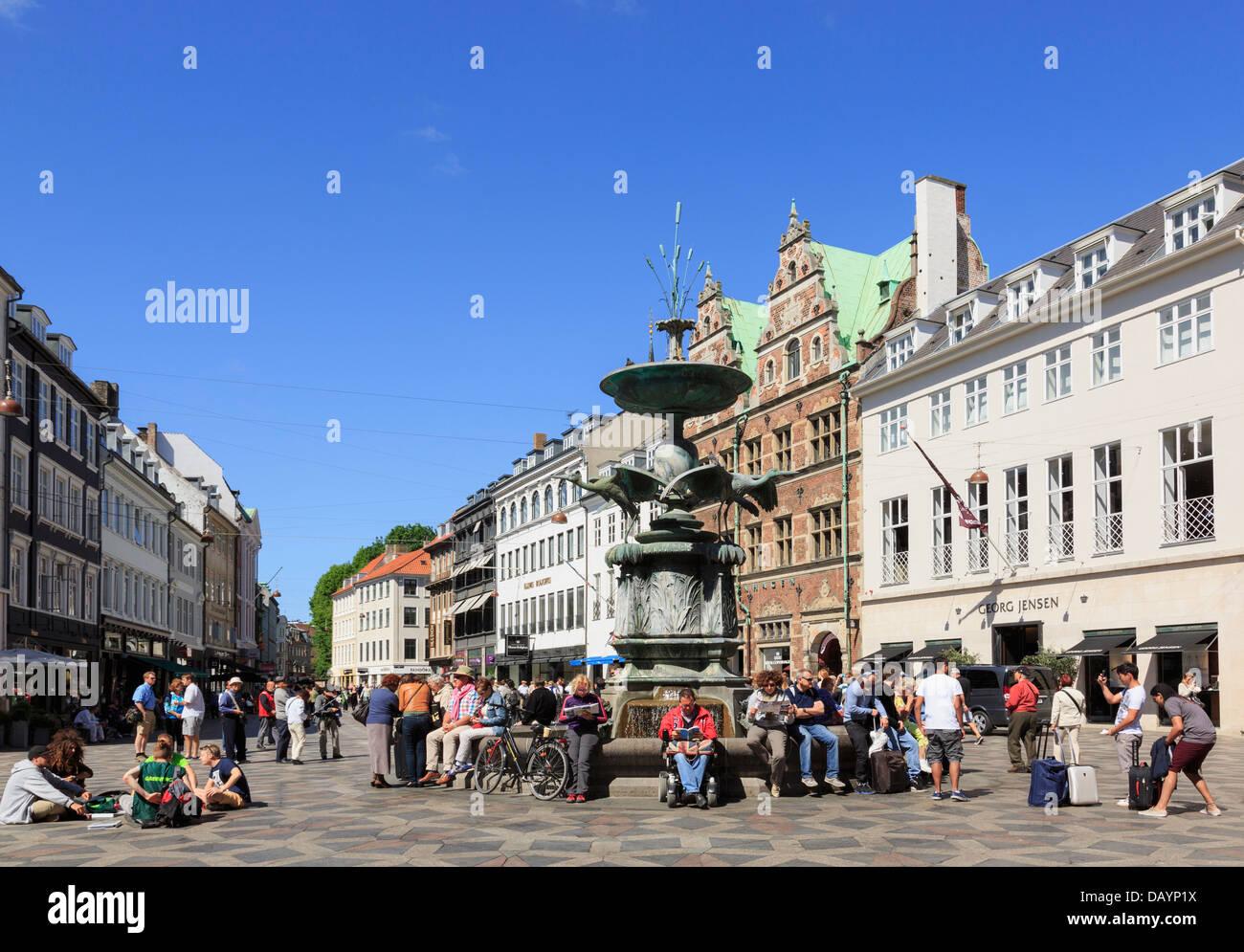 Old Amagertorv Square and Stork Fountain (Storkespringvandet) busy with people. Amager Torv Strøget Copenhagen - Stock Image