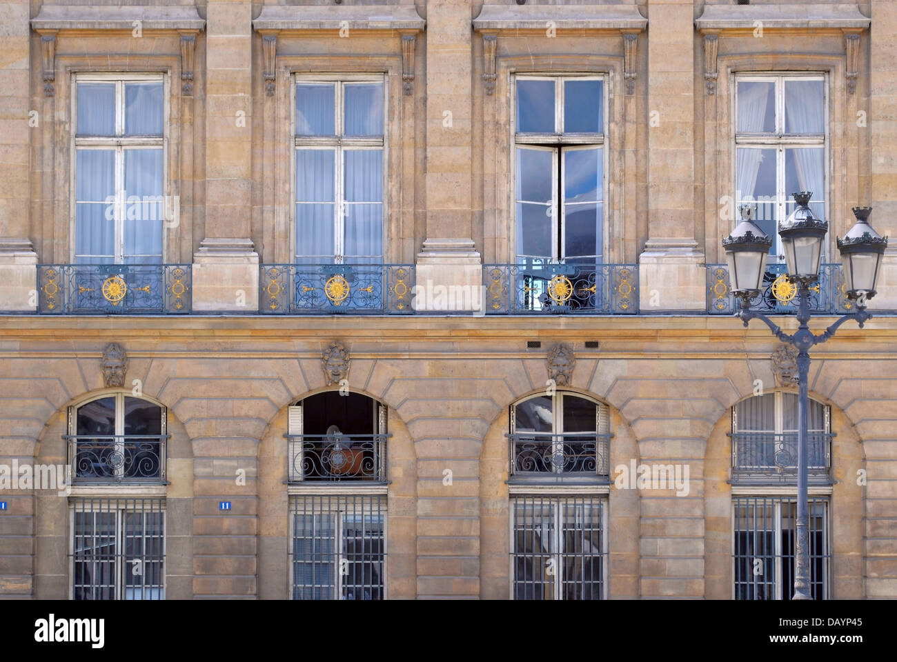 facade with large windows and a balcony hotel ritz in paris stock
