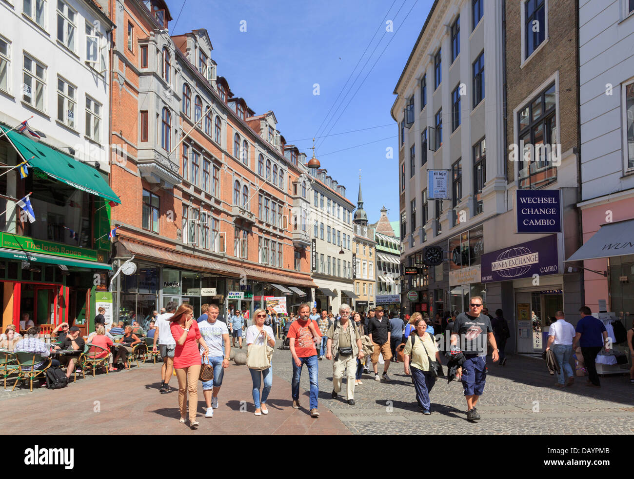 Pedestrianised shopping street in city centre busy with people, Strøget, Copenhagen, Denmark - Stock Image