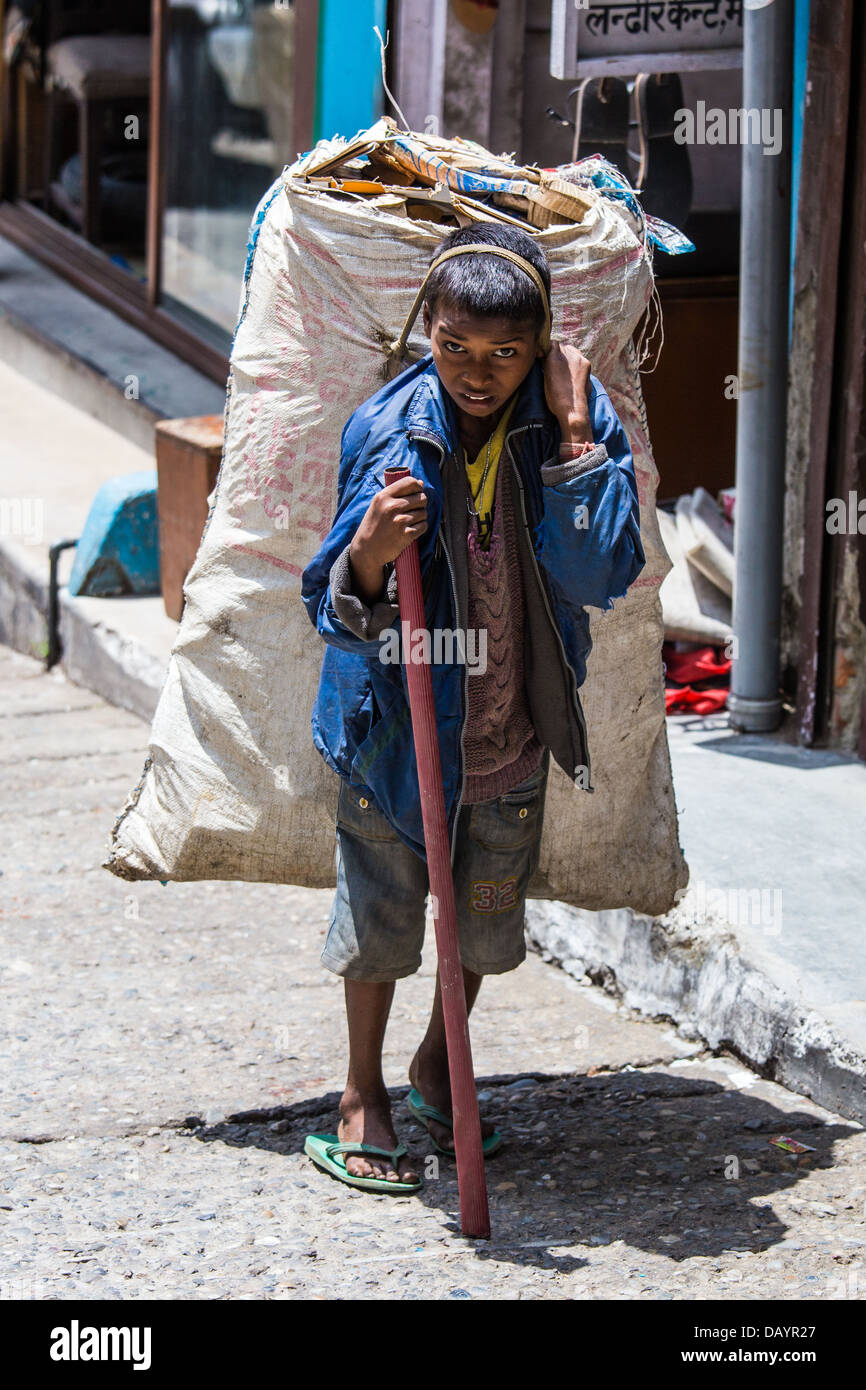 Indian boy gathering recycled material in Mussoorie, India - Stock Image