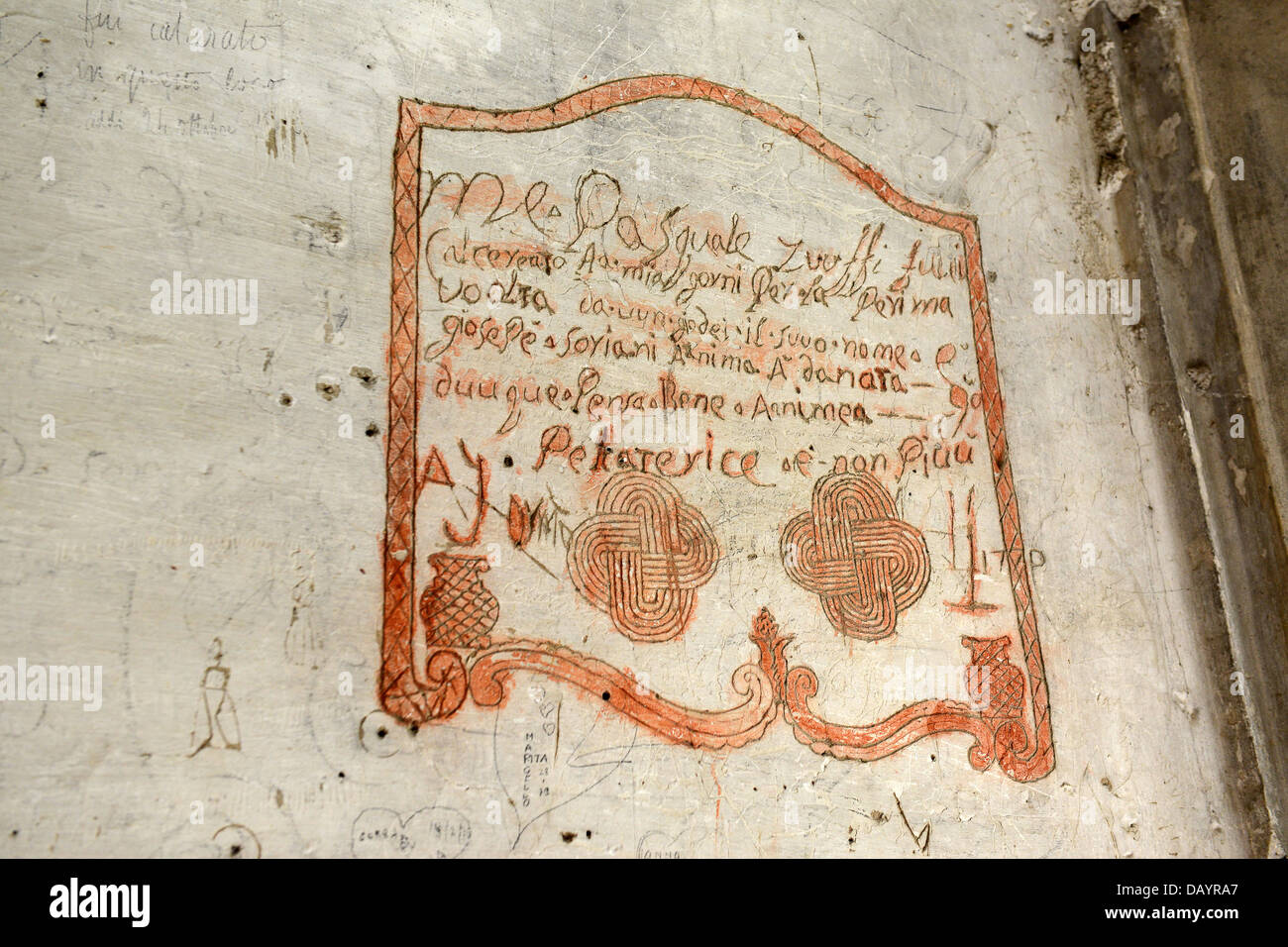 Graffiti and markings made by 18th century prisoners in the dungeon at Dozza Castle in Italy - Stock Image