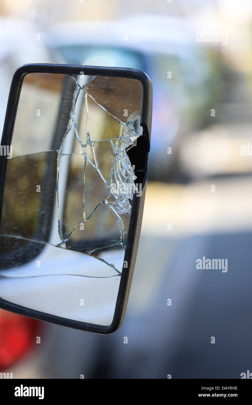 Broken wing mirror cracked glass - Stock Image