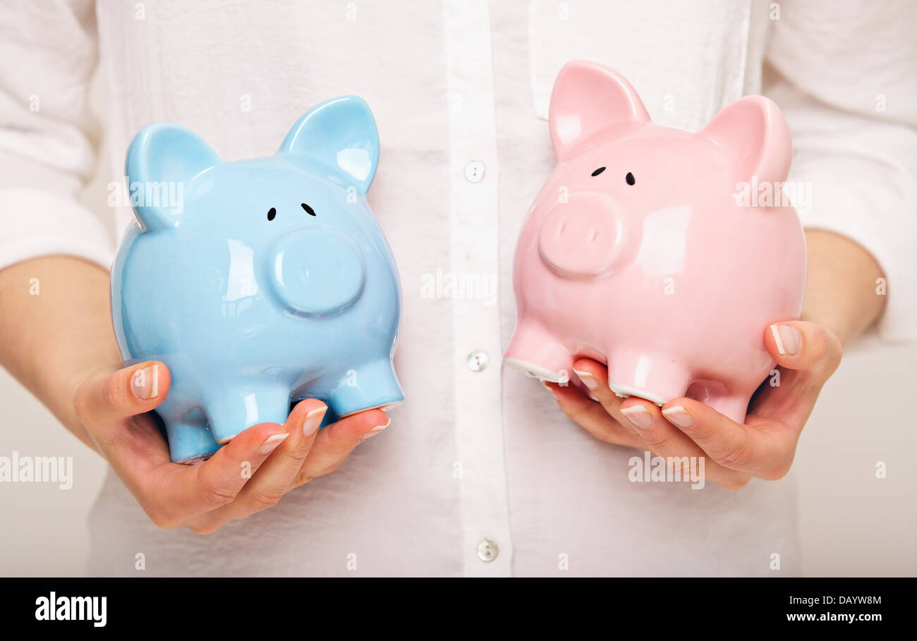 Two Coin Banks in my Hands - Stock Image