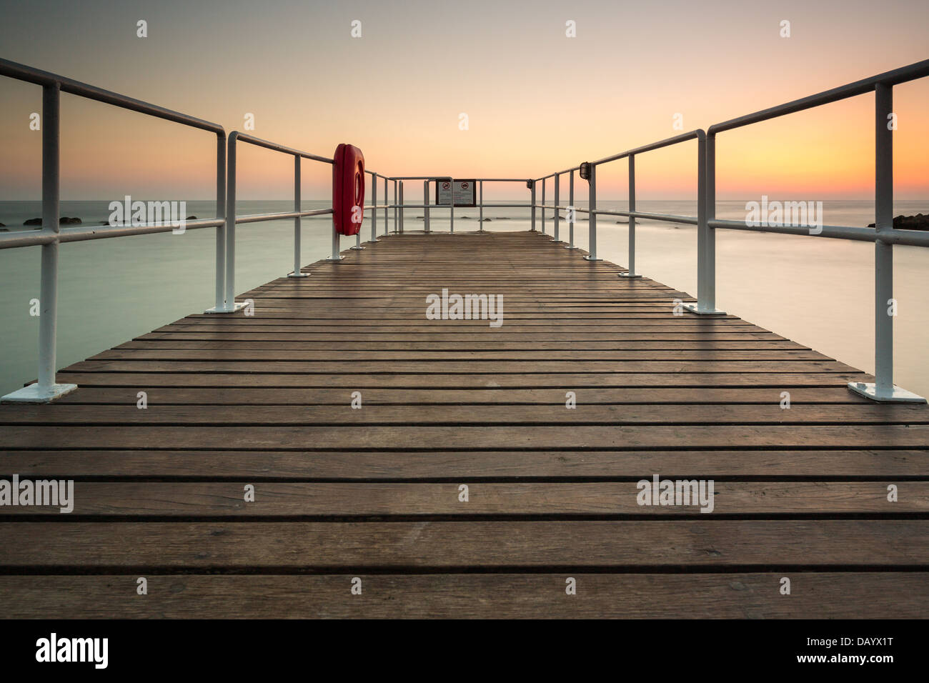 Paphos, hotel jetty in Cyprus at sunset - Stock Image