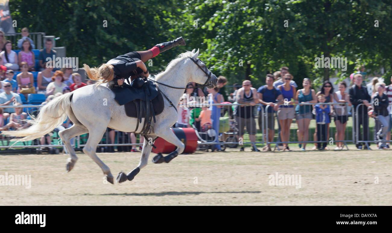 Glasgow, Scotland, 21st July, 2013. Amy Woodward stunt-co-ordinator of the Blazing Saddles Stunt Team, performing - Stock Image