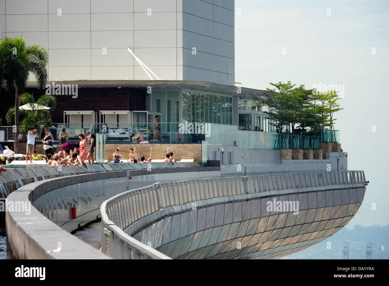 People relaxing at Marina Bay Sands Infinity Pool - Stock Image