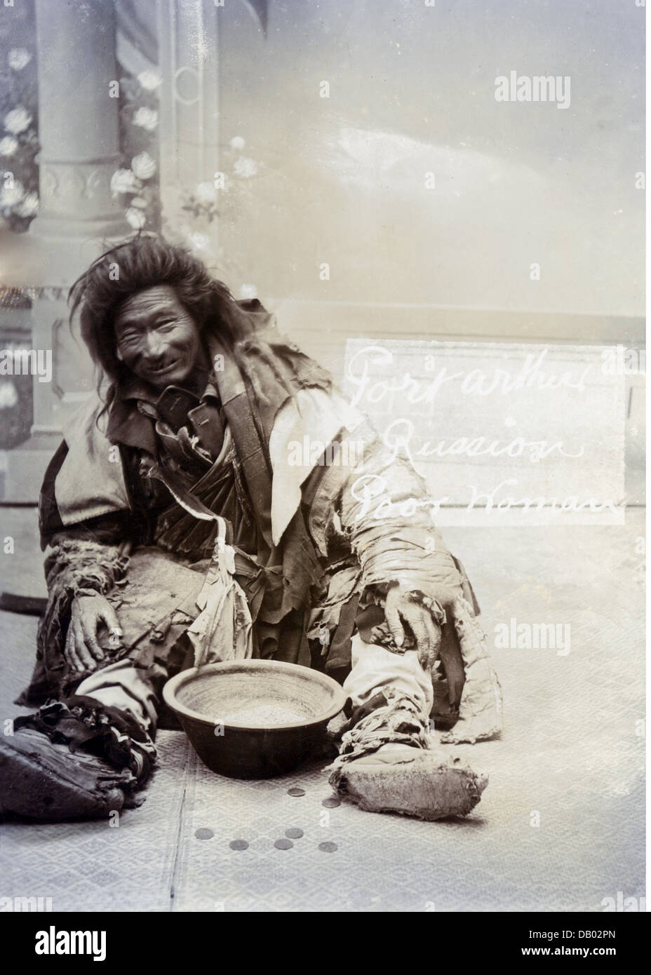 Gypsy beggar with a Russian child
