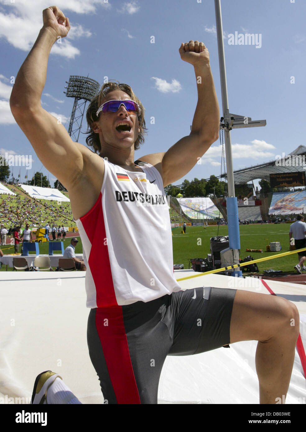 German pole-vaulter Tim Lobinger cheers after a jump over 5.70m which earned him the first place at the SPAR European - Stock Image