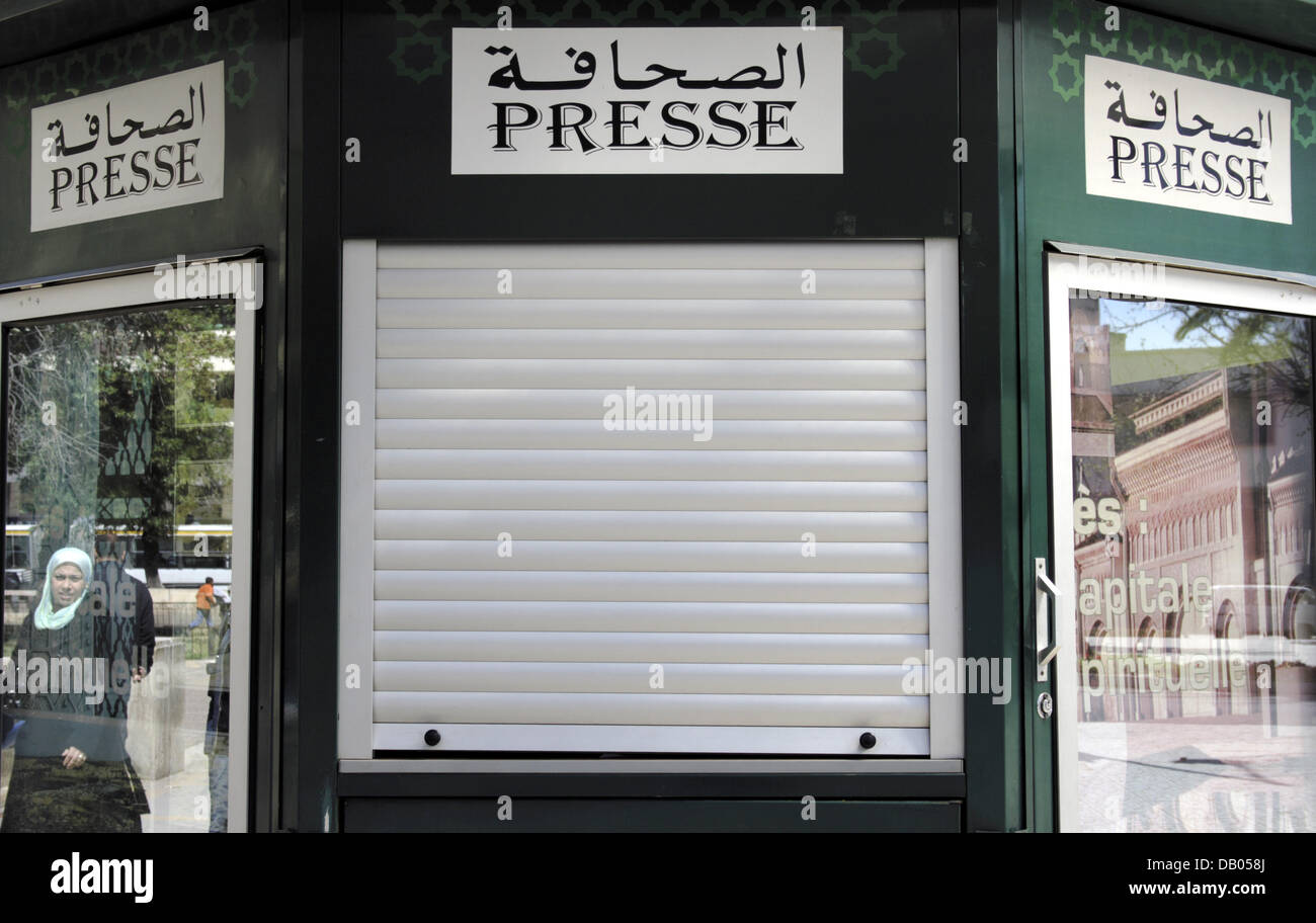 A sign of a newspaper stand reads 'Press' in Latin and Arabic in the King's city Fes, Morocco, 30 March 2007. Photo: Stock Photo