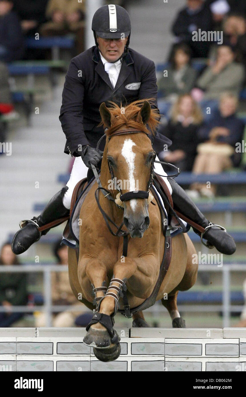 French equestarian Roger-Yves Bost and his horse 'Jalis de Riverland' take an obstacle at the World Equestarian - Stock Image