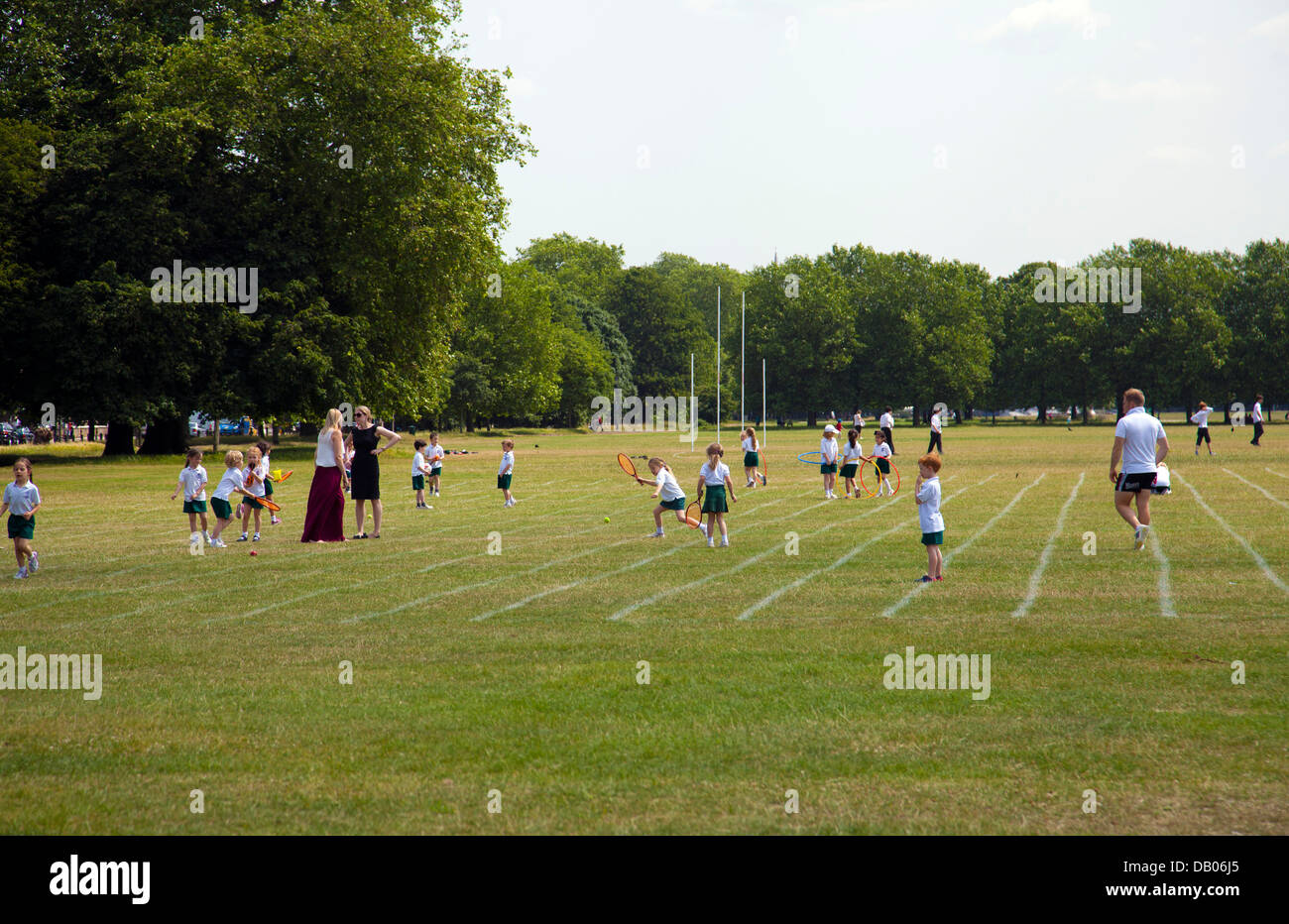 Young School Kids Playing on Clapham Common - London UK - Stock Image