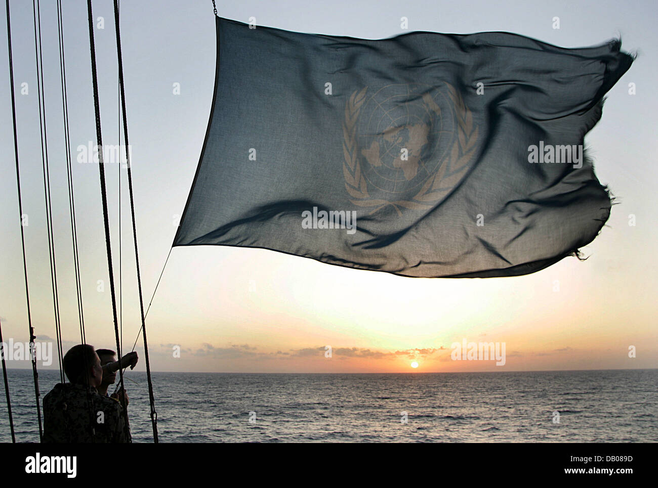 German Navy soldiers fly the flag on frigate 'Schleswig-Holstein' offshore the coast of Lebanon, 30 May - Stock Image