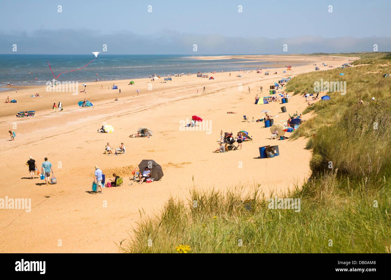 People on wide sandy beach Hunstanton Norfolk England - Stock Image