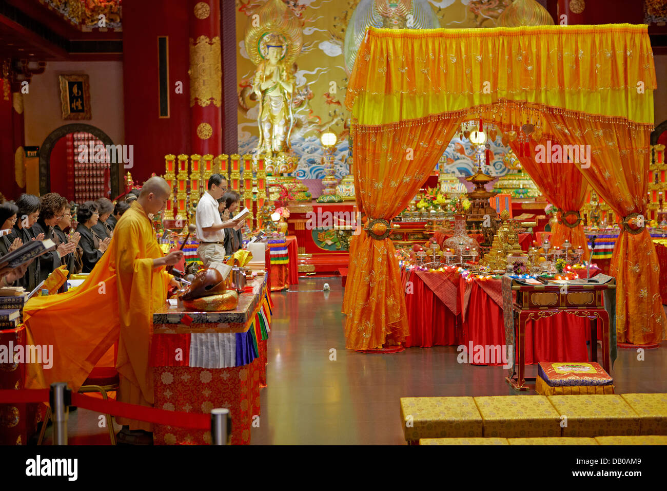 Buddhist ritual ceremony in Buddha Tooth Relic Temple. Chinatown, Singapore. Stock Photo