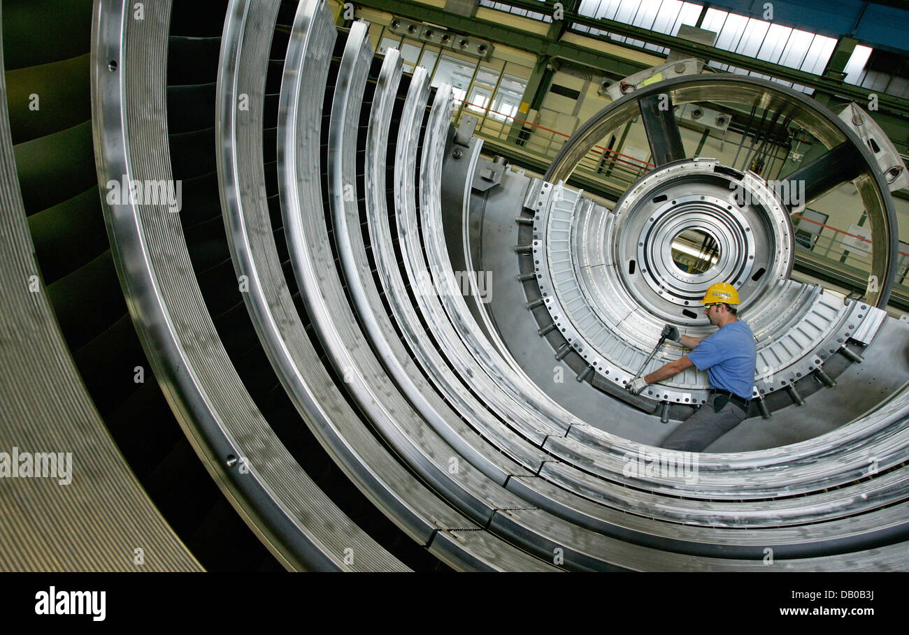 A worker assembles gas turbine parts at Siemens' historic gas