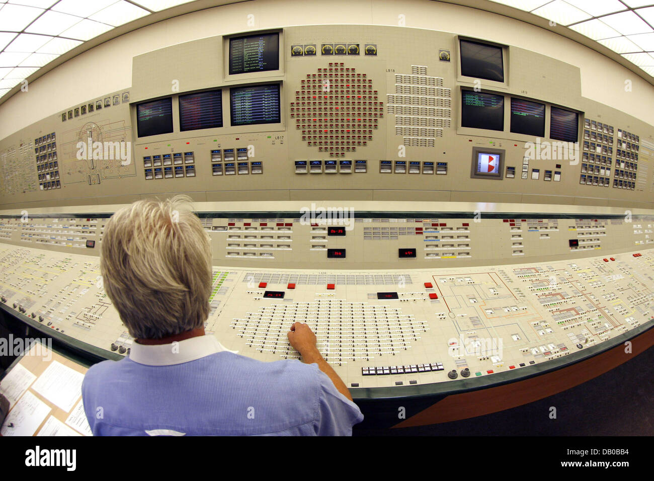 Kai Detlefsen, coach for reactor operators sits in an exact simulator of the reactor control stand at the nuclear Stock Photo