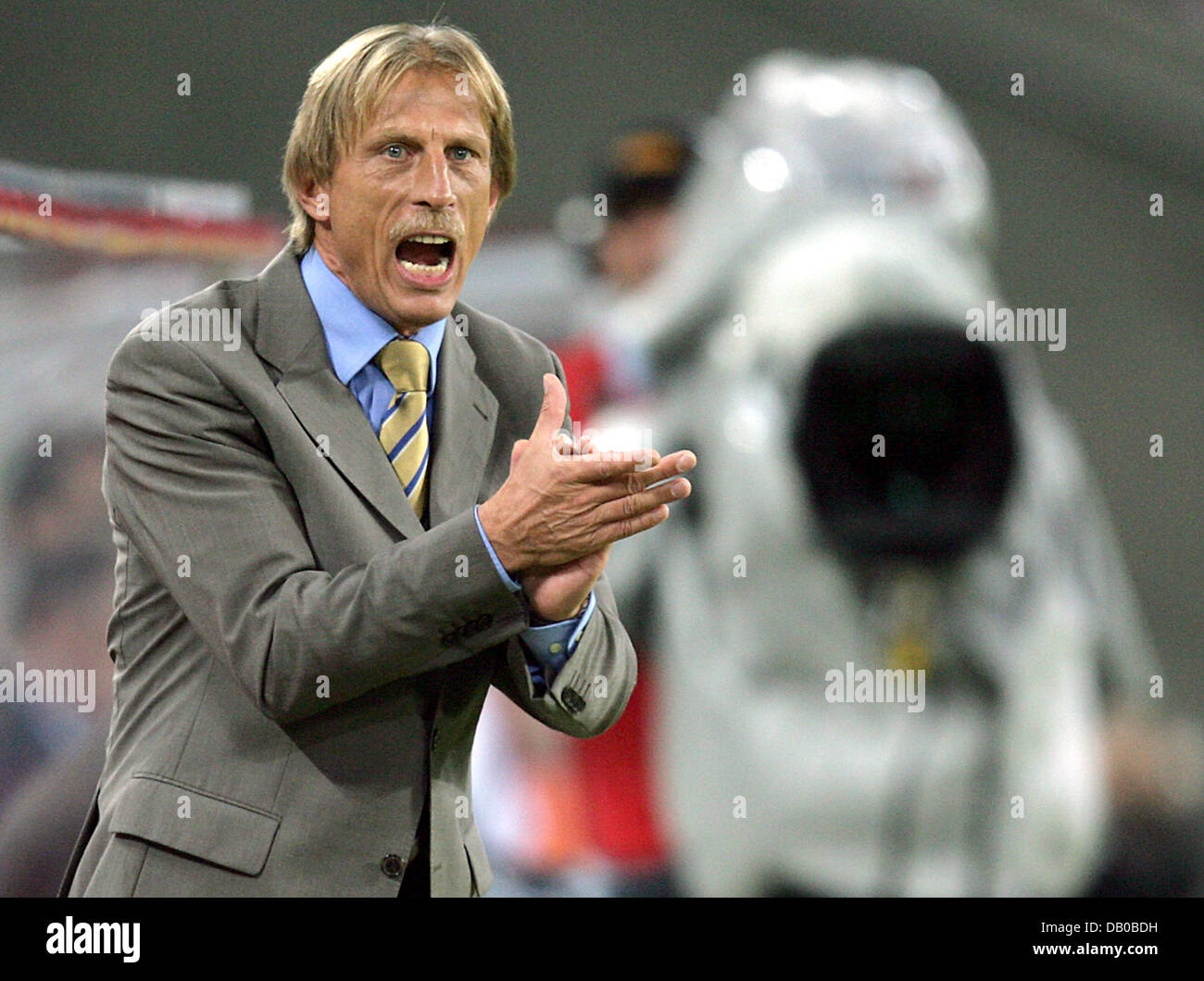 Cologne's head coach Christoph Daum gestures and shouts at the sideline during the soccer friendly 1st FC Cologne Stock Photo