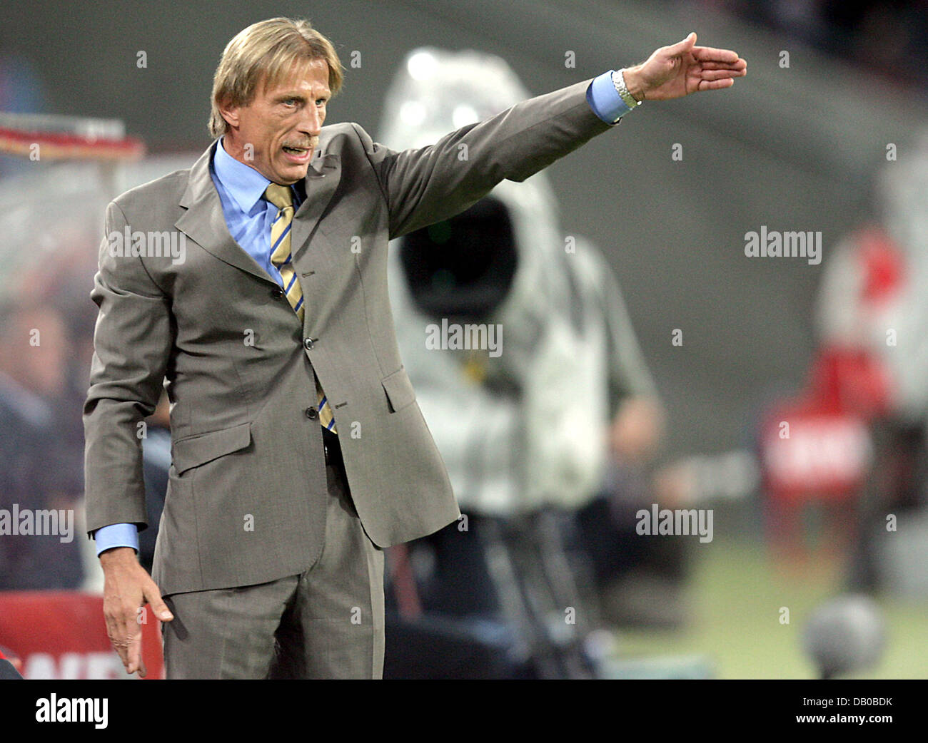 Cologne's head coach Christoph Daum gives directions from the sidelines during the soccer friendly 1st FC Cologne - Stock Image