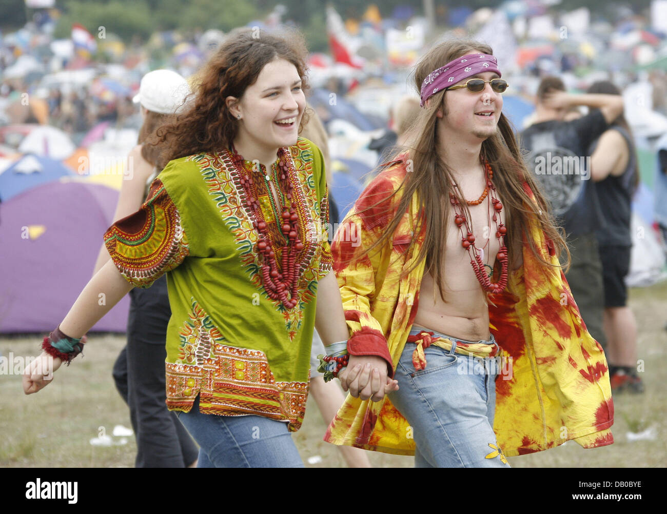 Two visitors pictured at Woodstock Festival in Kostrzyn, Poland, 03 August 2007. Organisers expect more than 300,000 - Stock Image