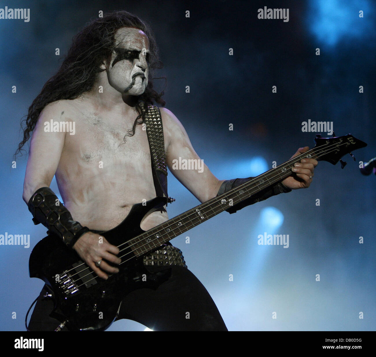 The bassist of the Norwegian black metal band 'Immortal' Apollyon is pictured on stage at the Wacken Open - Stock Image