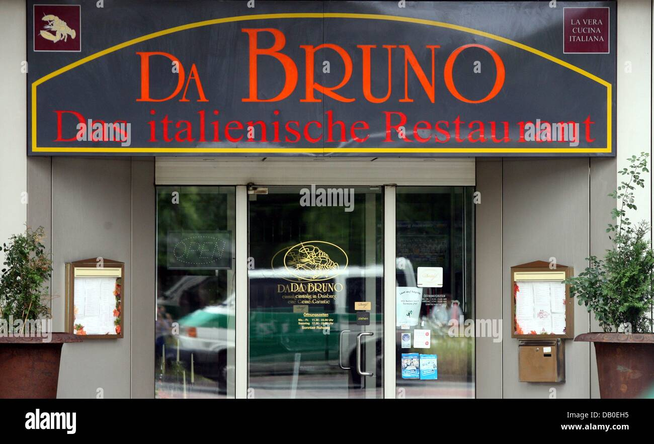 A Police Car Is Reflected In The Glass Door Of Italian Restaurant Da Bruno Near Central Station Duisburg Germany 15 August 2007