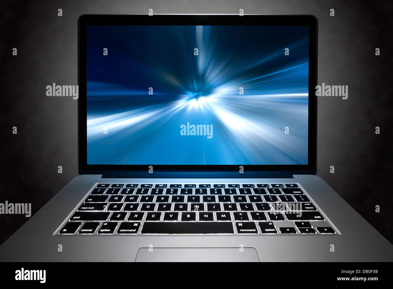 Front view of a Macbook Pro with Retina display with high-speed visual effect on its screen. - Stock Image