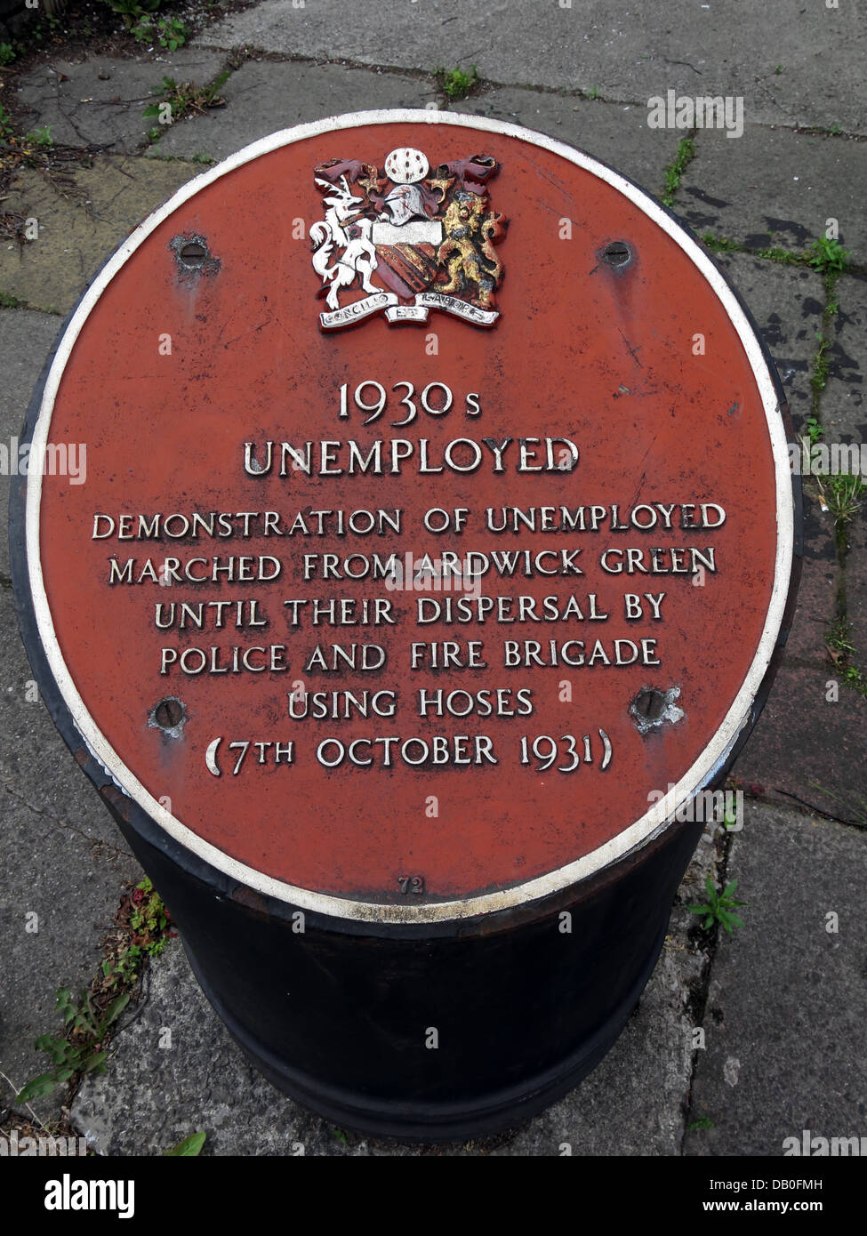Red plaque commemorating 1930s unemployed in Ardwick Manchester . Demonstration of unemployed marched from Ardwick Stock Photo