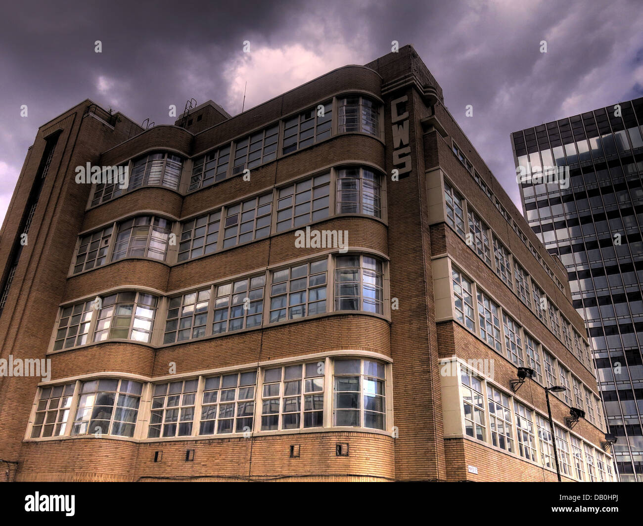 The 1920s style CWS building with stormy sky Stock Photo