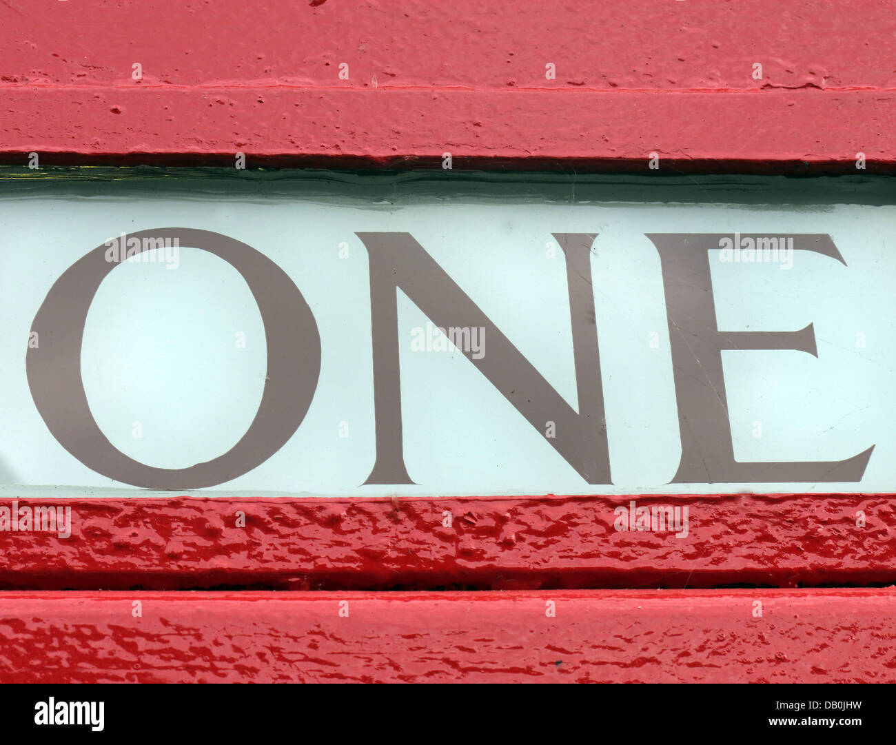 Detail of One ( 1 ) from a red British classic telephone box - Stock Image
