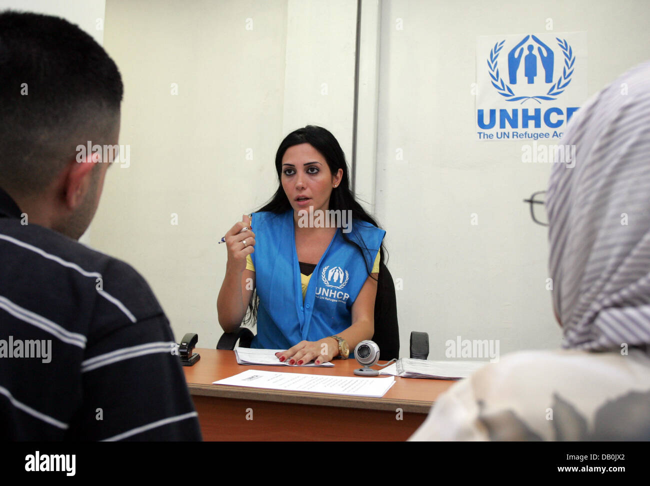 Staff of the UN's refugee agency UNHCR registers an Iraqi refugee family in a registration office for Iraqi - Stock Image