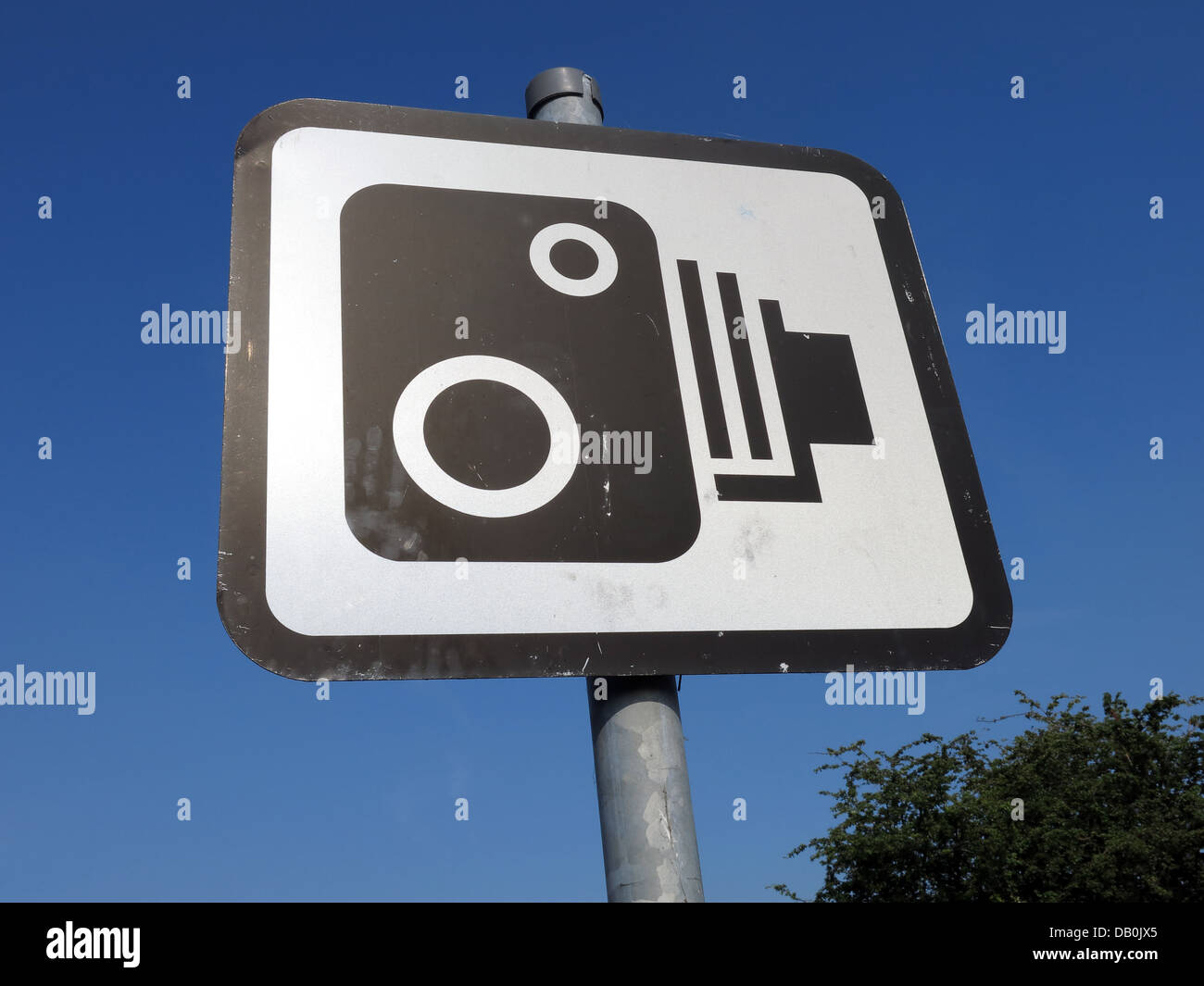 British speed camera sign in front of a summer blue sky - Stock Image