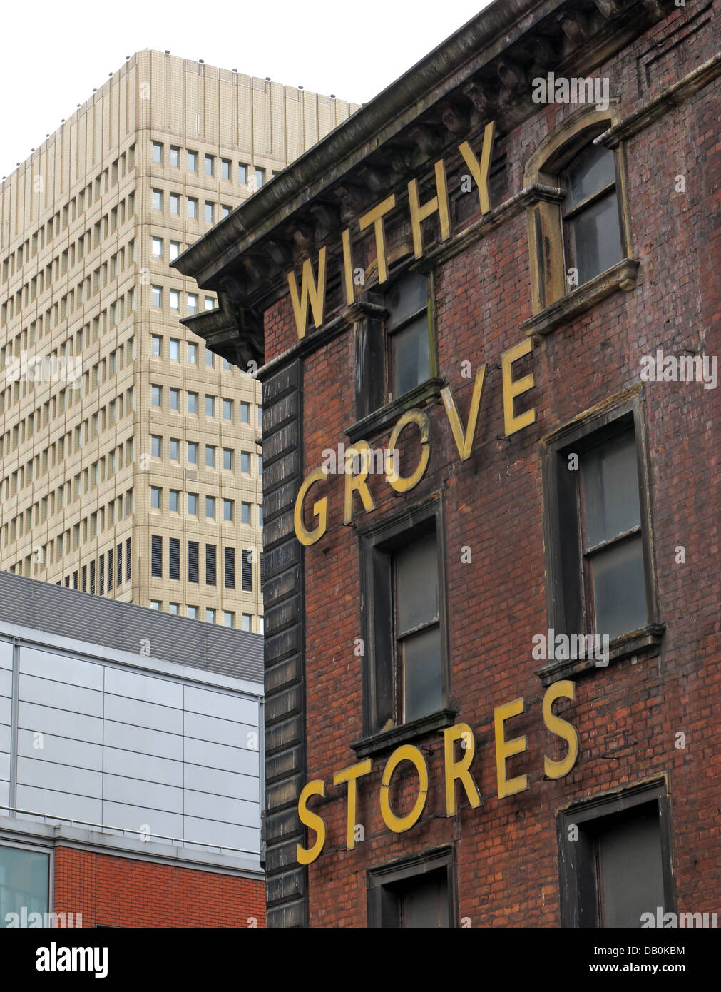The old withy Grove Stores victorian building in Shudehill Manchester City Centre with the 1970s Arndale shopping Stock Photo