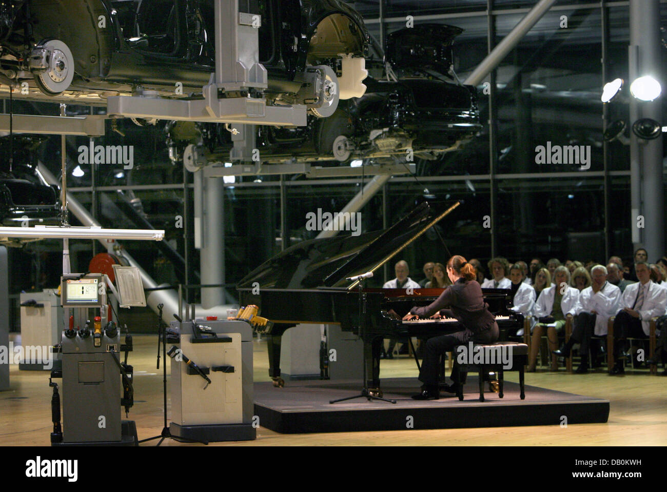 French pianist Helene Grimaud plays a concert at a Volkswagen automobile plant for people wearing white laboratory - Stock Image