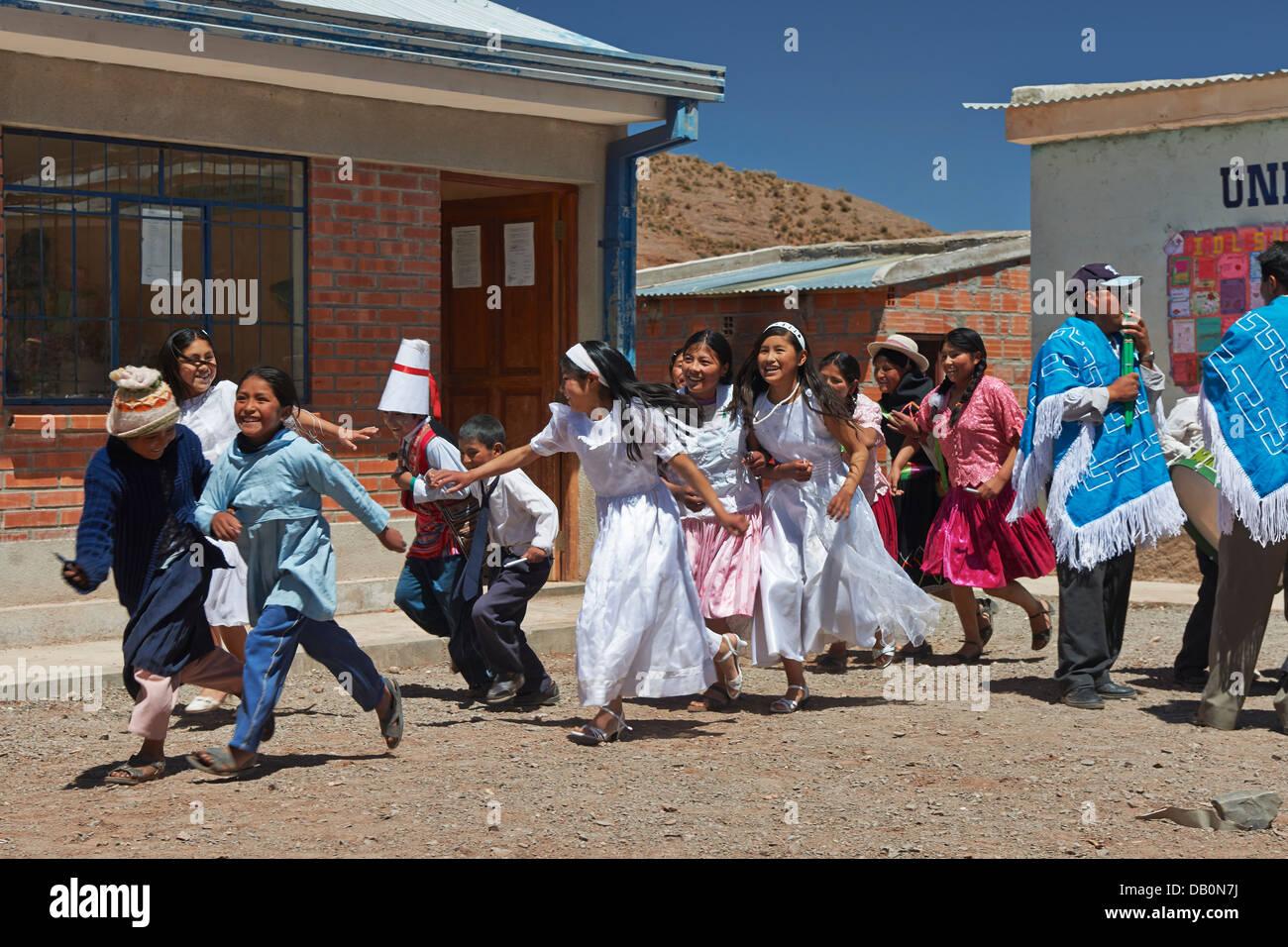 dancing indigenous Quechua children in village near San Antonio de Lipez, Andes, Bolivia, South America - Stock Image